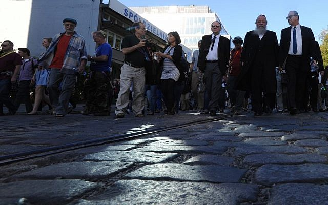 Marching through the streets of the former ghetto in Warsaw, Poland, on July 22 (photo credit: AP/Alik Keplicz)
