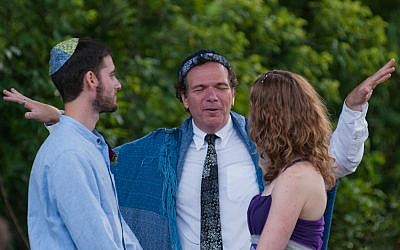 Illustrative: Rabbi Lev Baesh, center, marrying Jared and Laurie Berezin, an interfaith couple from Boston, Aug.19, 2011. (photo credit: courtesy, Jared and Laurie Berezin)