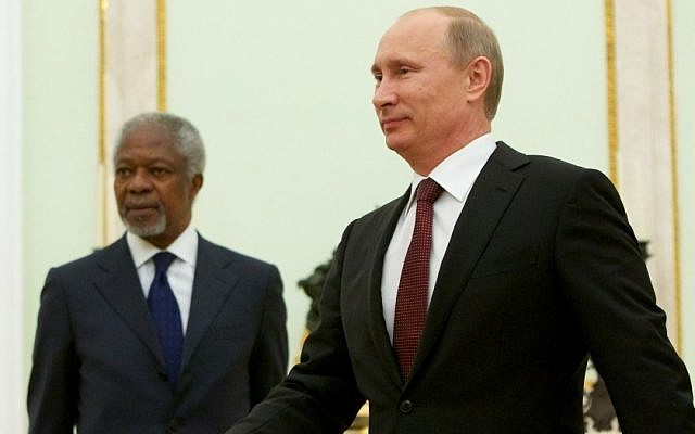 Russian President Vladimir Putin walks as United Nations special envoy Kofi Annan looks on before their talks in Moscow, Tuesday, July 17, 2012. (photo credit: Alexander Zemlianichenko/AP)