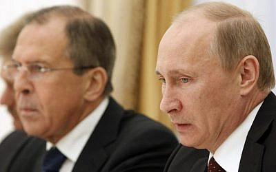 Russian President Vladimir Putin, right, and Foreign Minister Sergey Lavrov (photo credit: Sergei Karpukhin/AP)