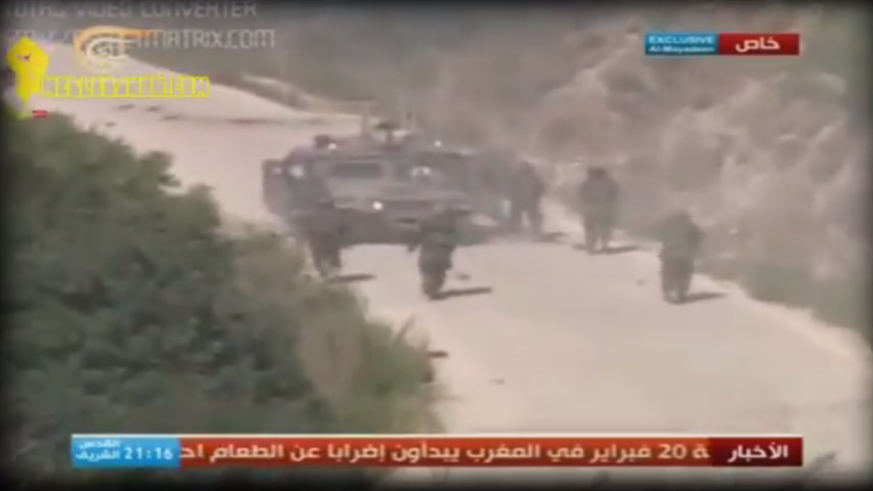 Hezbollah gunmen converge on the stricken Hummer of Regev and Goldwasser, in footage released by Hezbollah on Friday. (photo credit: screenshot)