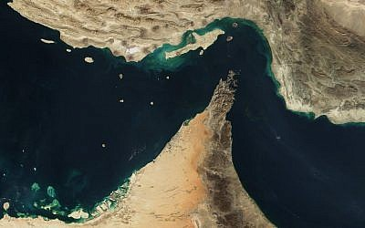Satellite view of the Strait of Hormuz with Iran on top and Gulf states including Dubai, UAE, Muscat and Abu Dhabi below. (photo credit: NASA/Public domain)