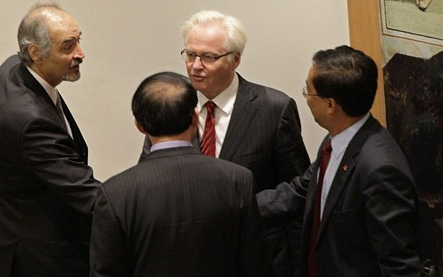 Syria's U.N. Ambassador Bashar Ja'afari, left, thanks a member of the Chinese UN delegation as China's UN Ambassador Li Baodong, second from right, and Russia's U.N. Ambassador Vitaly Churkin look on, after a Security Council meeting on the situation in Syria at the United Nations in New York in July 2012. (photo credit: AP)