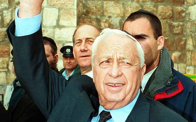 The newly-elected Israeli Prime Minister Ariel Sharon with then Jerusalem Mayor Ehud Olmert (back) visiting the Western Wall the morning following his victory over Ehud Barak. (photo credit: Nati Shohat/Flash 90)