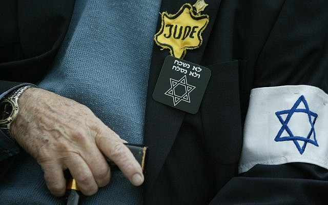 An unidentified Holocaust survivor sits holding his cane in the Yad Vashem Holocaust Memorial complex in Jerusalem (photo credit: Pierre Terdjman/Flash90)