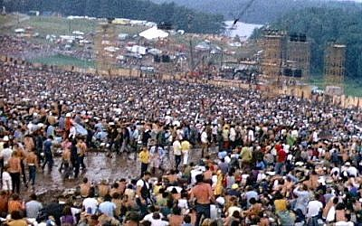 The crowd at Woodstock fills a natural amphitheatre with the stage at the bottom, August 1969 (photo credit: Derek Redmond and Paul Campbell/CCA-SA 3.0)
