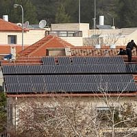 A home in Tzur Hadassah with a solar photovoltaic energy system installed on the roof. (Nati Shohat/Flash90)