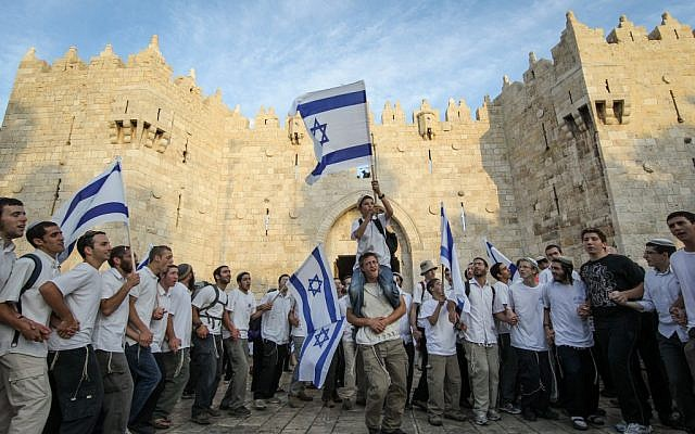 Thousands of Jews wave Israeli flags as they celebrate Jerusalem Day by walking the streets of Jerusalem, through Damascus Gate on their way to the Western Wall on May 20, 2012. (Nati Shohat/Flash90)