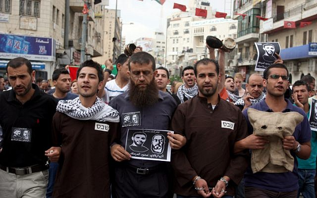Protesters call for the release of Palestinian prisoners during a demonstration in Ramallah in May. (photo credit: Issam Rimawi/Flash90)