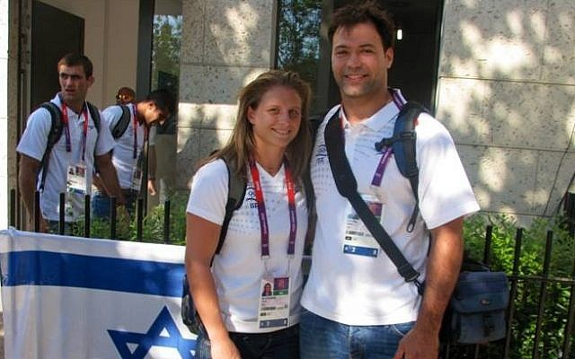 Two of Israel's judokas, Arik Zeevi (right) and Alice Schlesinger at the entrance to the Israeli building at the Olympic village, July 26 (photo credit: courtesy of the Israeli Olympic Committee)