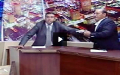 MP Shawabka (right) draws his gun, as the host tries to calm tempers, during a debate on Jordanian TV last week.  (photo credit: YouTube screen capture)