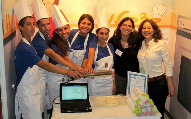 MamaBaker staff show off the Flour n'Roll (Photo credit: Courtesy)