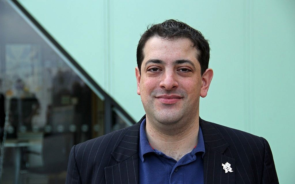 Rabbi Alex Goldberg wearing the official Olympic pin at the Surrey Sports Park,  the Olympic training camp to parts of team Great Britain, USA, China and others. (photo credit: Courtesy)