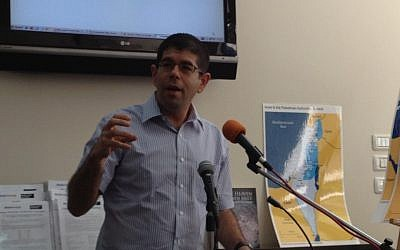 Peace Now director Yariv Oppenheimer speaking in Jerusalem this week (photo credit: Raphael Ahren/Times of Israel)