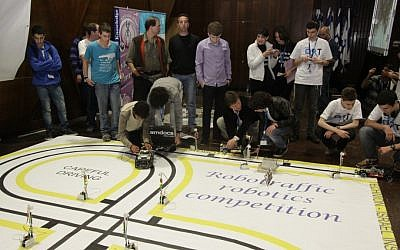 Students present their project at the recent Robotraffic contest (Photo credit: Courtesy) Students present their projects at the recent Robotraffic contest (Photo credit: Courtesy)