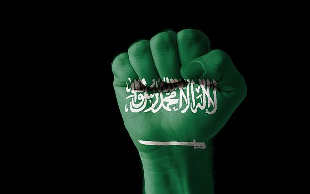 (Saudi flag fist via Shutterstock)