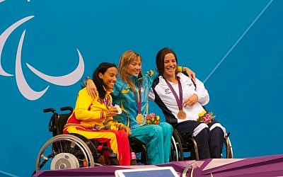 Israeli swimmer Inbal Pezaro, right, holds the bronze medal she won in the 50 meter freestyle event at the 2012 Paralympic Games in London on Thursday, August 30, 2012. (photo credit: Razi Livnat)