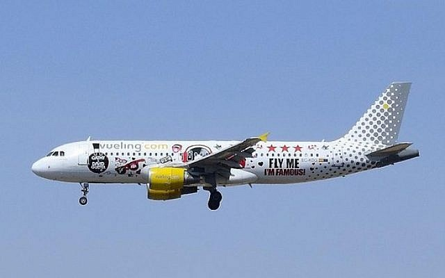 A Vueling plane in flight. (illustrative photo; photo credit: CC-BY Vince_Vega, flickr)