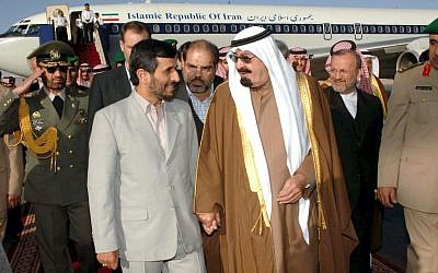 Iranian President Mahmoud Ahmadinejad is greeted by Saudi Arabia's King Abdullah during his first official visit to Saudi Arabia, March 3, 2007 (photo credit: AP)