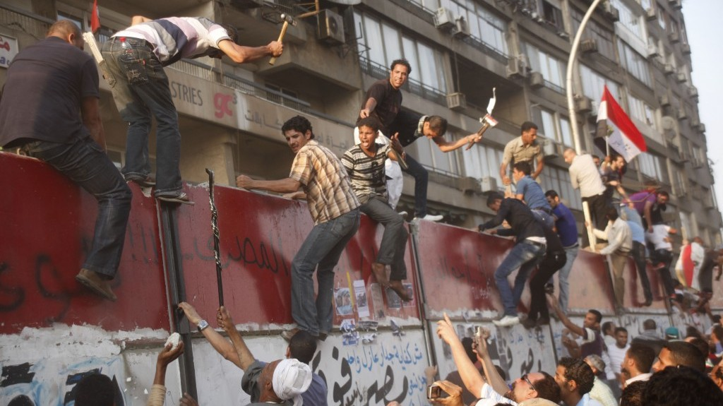 Egyptian protesters demolish a concrete wall protecting the Israeli embassy in Cairo, September 9, 2011 (photo credit: AP/Amr Nabil)