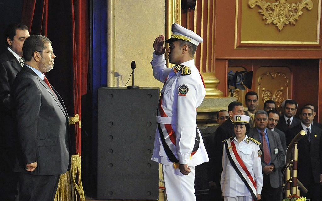 Mohammed Morsi at a graduation ceremony at the Police Academy headquarters in Cairo, July 14 (photo credit: AP Photo/Ahmed Mourad)