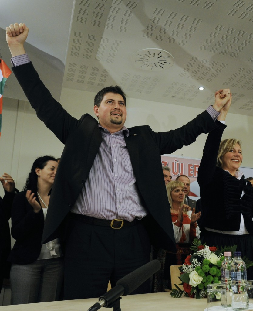 Csanad Szegedi celebrating his entry into the European Parliament after the European parliamentary election in Budapest, Hungary in 2009. (photo credit: AP Photo/Bela Szandelszky, File)