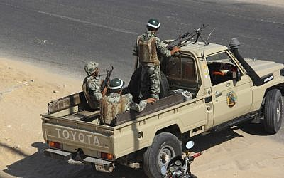 Egyptian army personnel guard the road outside Rafah, Egypt, Monday, Aug. 6, (photo credit: AP)