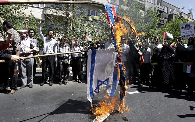 Iranian demonstrators burn an Israeli and British flag during an annual pro-Palestinian rally marking Quds (Jerusalem) Day, on the last Friday of the holy month of Ramadan, at the Enqelab-e-Eslami (Islamic Revolution) St. in Tehran, August 17, 2012 (photo credit: AP Photo/Vahid Salemi)