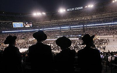 Ultra-Orthodox Jews celebrating the Siyyum Hashas, or end of the 7.5 year Talmud learning cycle, in New Jersey's MetLife Field Wednesday night. (photo credit: AP/ Mel Evans)