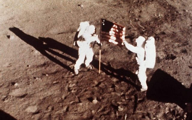 "This July 20, 1969 file photo provided by NASA shows Apollo 11 astronauts Neil Armstrong and Edwin E. ""Buzz"" Aldrin, the first men to land on the moon, plant the U.S. flag on the lunar surface. (photo credit: AP Photo/NASA)"