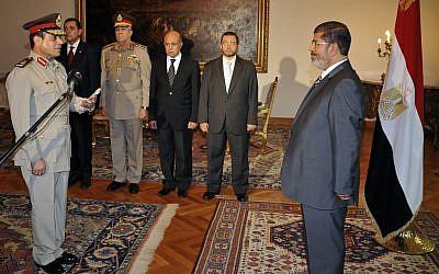 Egyptian President Mohammed Morsi swears in Minister of Defense, Lt. Gen. Abdel-Fattah el-Sissi August 12 (photo credit: AP photo)