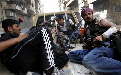 Rebels in Aleppo last week. (photo credit: AP/Alberto Prieto)