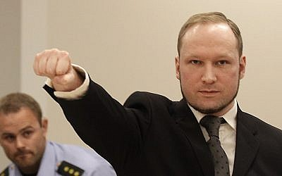 Anders Breivik saluting upon entering the courtoom Friday. (photo credit: AP/Frank Augstein)
