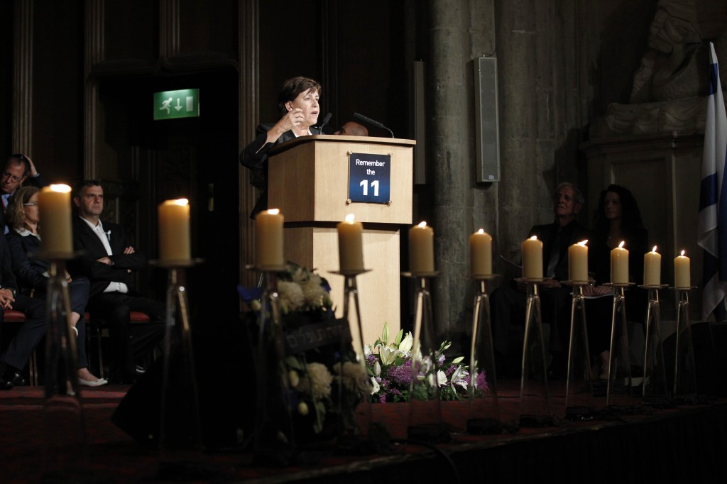 Ankie Spitzer, widow of one of the 11 members of the Israeli team who were killed in the terrorist attack at the 1972 Munich Olympic Games, addresses guests at a memorial ceremony at Guildhall in London on Monday, Aug. 6, 2012. (photo credit: Sang Tan/AP)