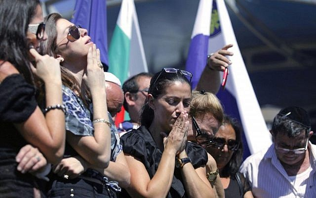 Relatives of five Israeli victims of a suicide bomber who targeted a bus of Israeli tourists a month earlier, mourn during a commemoration ceremony at Burgas airport. (photo credit: AP)