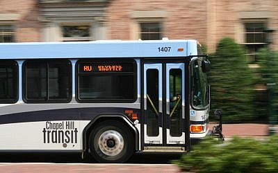 Chapel Hill Transit bus driving by a building at the University of North Carolina (photo credit: CC BY-SA 3.0, by Specious, Wikimedia Commons)