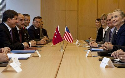 US Secretary of State Hillary Rodham Clinton, at far right, meets with Turkey's Foreign Minister Ahmet Davutoglu, at far left, in Istanbul in early August (photo credit: AP/Jacquelyn Martin, Pool)