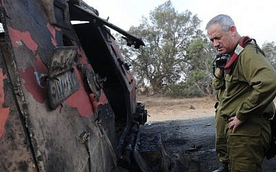 Benny Gantz inspects a burnt out personnel carrier after the August 5 attack on the Israel-Egypt border. (photo credit: IDF Spokesman's Unit)