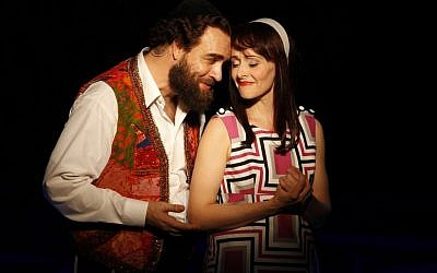 Eric Anderson and Julie Osborne as Shlomo Carlebach and his wife Neila, from the off-Broadway play 'Soul Doctor.' (photo credit: Carol Rosegg/JTA)