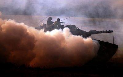 Illustrative photo of Israeli soldiers training in the Golan (photo credit: Abir Sultan/Flash90)