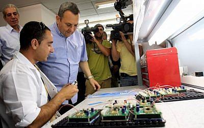 Former Defense Minister Ehud Barak on a visit to the Elbit factory in Sderot (photo credit: Edi Israel/Flash90)