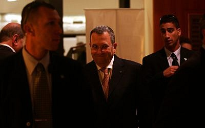 Ehud Barak -- defense minister and former prime minister -- surrounded by security guards (photo credit: Kobi Gideon/Flash90)