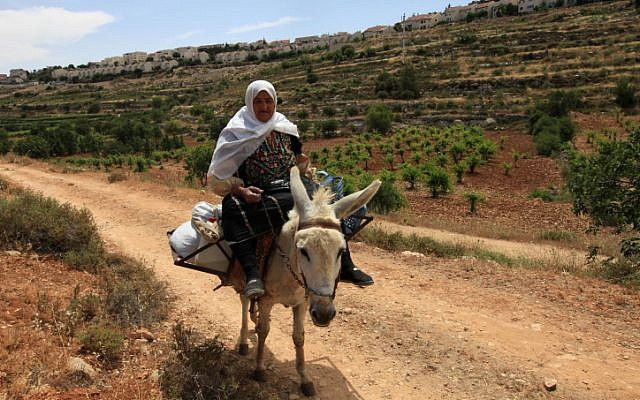 Illustrative photo of a woman riding a donkey. (photo credit: Nati Shohat/Flash90)