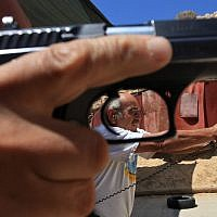 Illustrative: Man holding a handgun. (Nati Shohat/Flash90)