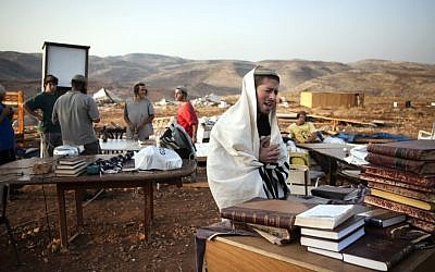 A settler prays at the Maoz Esther outpost in the West Bank (photo credit: Matanya Tausig/Flash90)