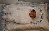 Illustrative: A baby after the brit milah ceremony (Gershon Elinson/Flash90)