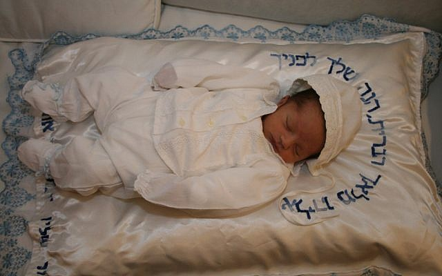 Illustrative: A baby after the brit milah ceremony (Gershon Elinson/Flash90)