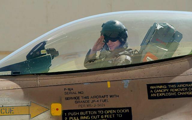 An Israeli Air Force pilot salutes from the cockpit of an F-16 at an air force base in the Negev. (photo credit: Moshe Shai/Flash90)