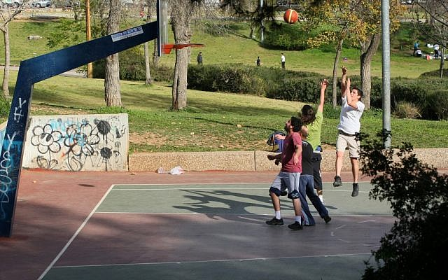 Boys playing basketball in Jerusalem (Illustrative photo: Kobi Gideon/Flash90)