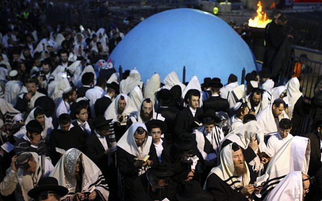 Ultra-Orthodox men celebrate Lag BaOmer at Mount Meron (photo credit: Abir Sultan/Flash90)